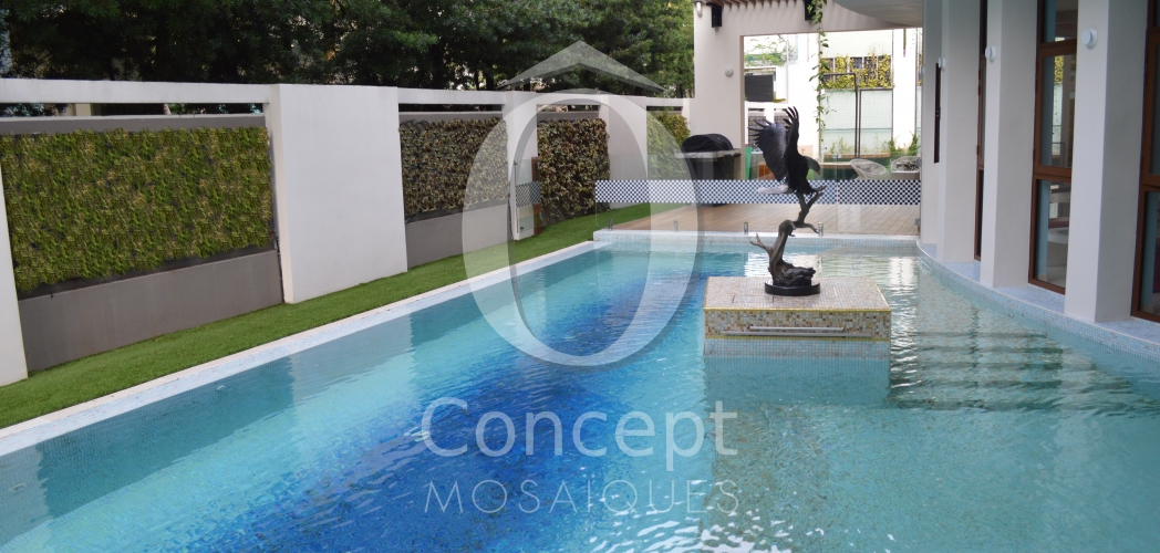 "Mosaic pool with an ""atoll"" effect by Ô Concept"